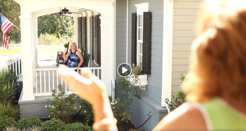 neighbors waving from porches