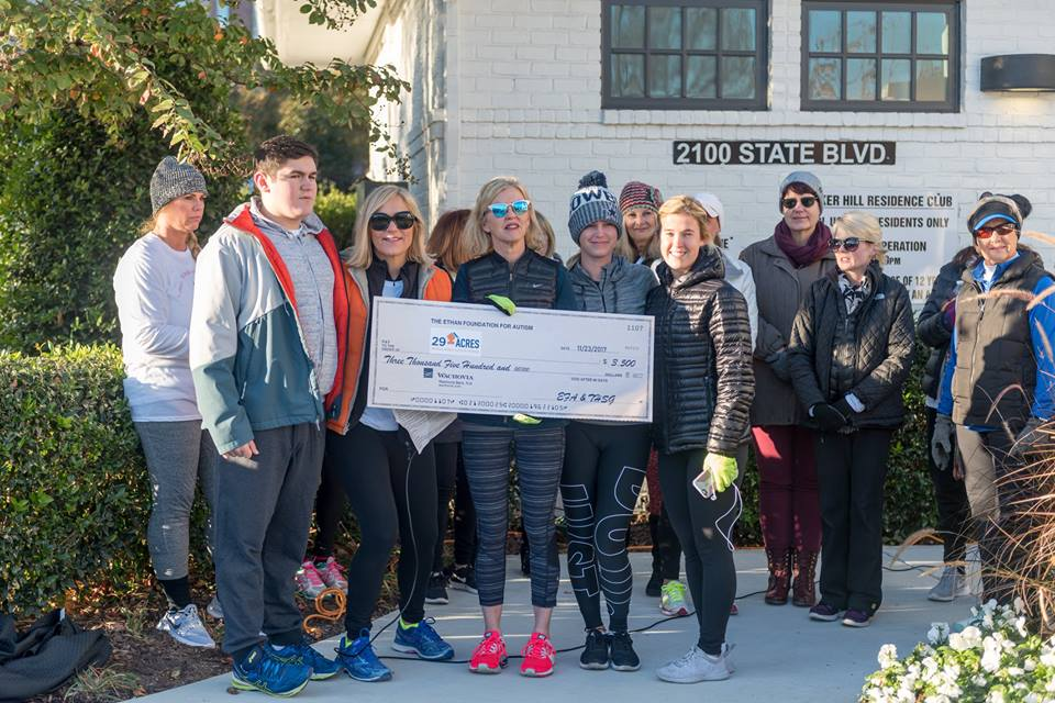 Tucker Hill residents present funds from Turkey Trot